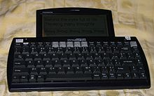 a communication device resembling a computer keyboard with a small liquid-crystal display attached to the top