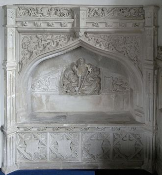 Easter Sepulchre - Easter Sepulchre, 16th century, Holcombe Burnell Church, north wall of chancel. Monument to an unidentifiable member of the Denys family, lords of the manor. The main panel shows Christ rising from the tomb, with slumbering guards. Transitional in style, Renaissance classical elements are shown such as a classical pediment and Italianate putti, but the whole is contained within a late Gothic arch