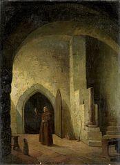 Een monnik met een glas in de hand in een kelder