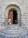 Entrance door of Saint-Nectaire church.jpg
