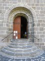 Entrance door of Saint-Nectaire church.jpg