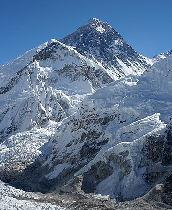 Mount Everest, the highest peak on earth, lies on the Nepal-China border. Everest kalapatthar crop.jpg