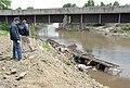 FEMA - 30772 - FEMA Community Relations workers examine a destroyed home in Missouri.jpg