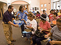 FEMA - 37439 - Representatives from the Texas Department of Insurance and FEMA hand water to residents.jpg