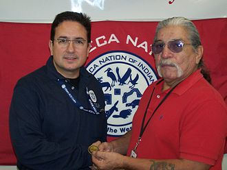 Federal Emergency Management Agency (FEMA) officer present an award to Art John, Director of Emergency Response for the Seneca Nation of Indians, 2009 FEMA - 42287 - FEMA FCO makes an award in New York.jpg