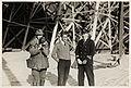Filmfotograf Paul Berge og mekaniker Oskar Omdal sammen med en uidentifisert person foran luftskiphallen i Ny-Ålesund, 1926 (8887043031).jpg