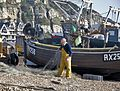 Fishing man sorting out his nets, Hastings (6536963805).jpg