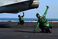 Flight deck crewmen give the thumbs up to launch an F-A-18F Super Hornet from the aircraft carrier USS John C. Stennis (CVN 74) as the ship operates in the Arabian Sea on Dec 121229-N-OY799-198.jpg