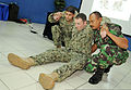 From left, U.S. Navy Hospital Corpsman 2nd Class Arman Hajiomar, Hospital Corpsman 2nd Class Joseph Davies, with Maritime Civil Affairs and Security Training Command, and an Indonesian sailor demonstrate 130522-N-NX489-085.jpg