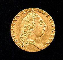 Gold coin bearing the prcủaile của một round-headed George wearing một classical Roman-style haircut và laurel-wreath.