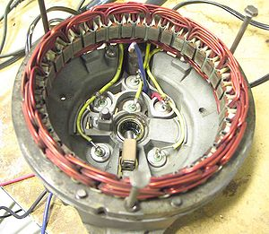 Rectifier - Disassembled automobile alternator, showing the six diodes that comprise a full-wave three-phase bridge rectifier.