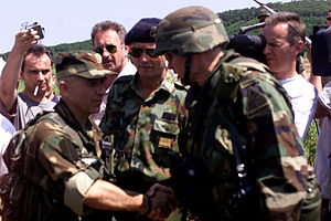 Goran Radosavljević - Brig. Gen. Kenneth Quinlan (foreground, right), the Commanding General of Task Force Falcon meets the Guri at the administrative boundary between Kosovo and Serbia during a meeting to discuss the success of the Ground Safety Zone reduction on May 30, 2001.