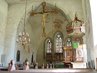 Rood - Hanging rood with no rood screen but with Mary (left) and John as attendant figures in Lye Church on the island of Gotland in Sweden