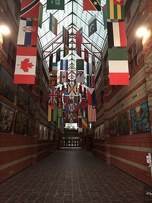 Cape Breton University - The Great Hall in the Culture and Heritage Centre, featuring flags from the various countries represented by CBU's international students.