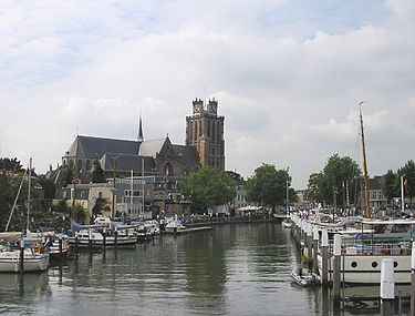 The Grote Kerk and one of the many canals (New Harbor) Grote Kerk, Dordrecht.jpg