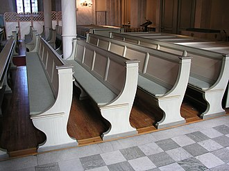 Pew - Pews in rows in a church