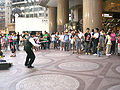 HK CWB Times Square Yue Minjun Art Exhibition 2008 Street Busking Evening a.jpg