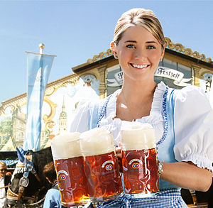 Seasonal beer - A waitress with Hacker-Pschorr, one of the traditional Oktoberfestbiers brewed for Oktoberfest festival. She wears a dirndl, a traditional women's dress of Bavaria.