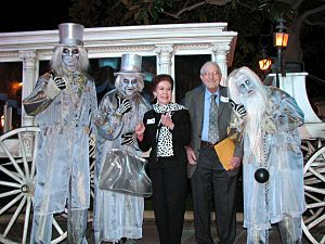 Partners (statue) - Blaine Gibson is shown surrounded by actors portraying his creations in the Haunted Mansion.