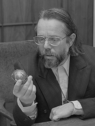Harvey Cox - Cox examining a Honeywell fragmentation device (1973)