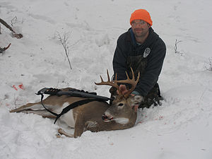 Hunter with buck.jpg