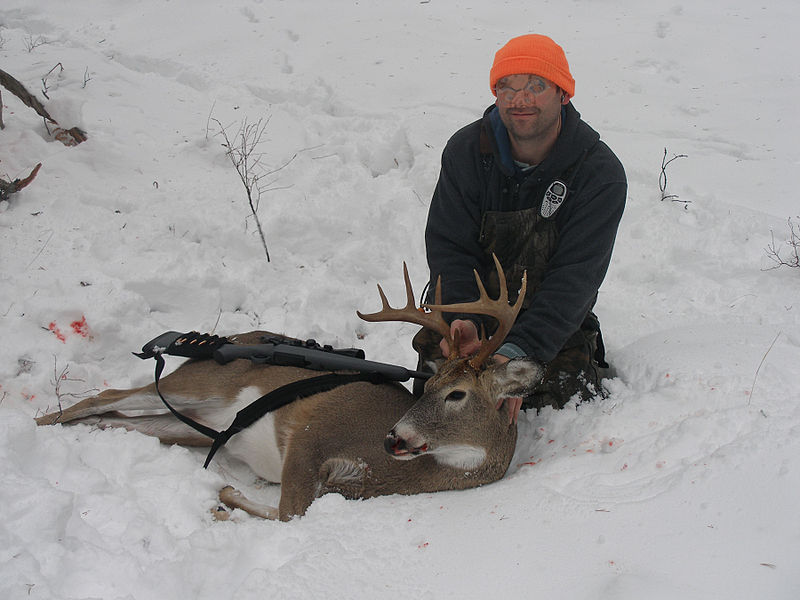 File:Hunter with buck.jpg