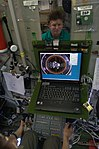 ISS-20 Gennady Padalka trains the relocation of the Soyuz TMA-14 spacecraft in the Zvezda Service Module.jpg