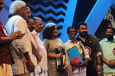 Parvathy and Indrans receiving the Best actress and actor award for 2017 Indrans and Parvathy on Folm Award 2018.jpg
