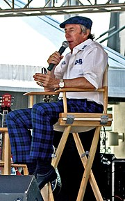 Jackie Stewart speaking at the 2005 United States Grand Prix.