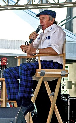 Jackie Stewart speaking.jpg