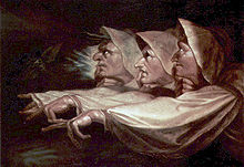 Painting showing three faces with hooked noses in profile, eyes looking up. Each has an arm outstretched with crooked fingers.