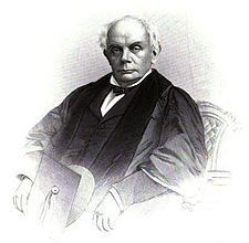 A partially completed black-and-white illustration of a seated old man in academic robes