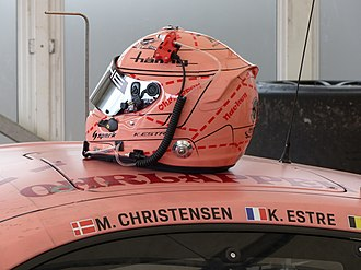Kévin Estre - Kévin Estre painted his helmet in the same colours as the Porsche he drove at the 2018 Le Mans 24 hours.  The car was in turn painted in honour of the Pink Pig Porsche 917, which raced at the Le Mans race in 1971, and which had a similar porcine hue.
