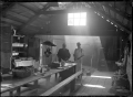 Kitchen interior. The cookhouse at the timber camp at the Piha Mill. ATLIB 170363.png