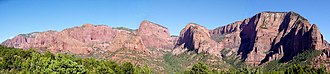 Geology of the Zion and Kolob canyons area - Kolob Canyons from the end of Kolob Canyons Road. Stream erosion has incised the Kolob Plateau to form canyons that expose the red-orange colored Navajo Sandstone and other formations.
