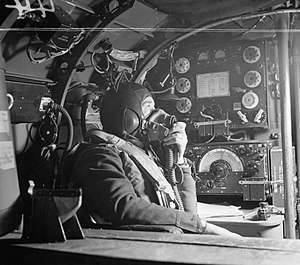 No. 57 Squadron RAF - Flying Officer R.W. Stewart, a wireless operator on a Lancaster of 57 Squadron based at RAF Scampton speaking to the pilot from his position in front of the Marconi T1154/R1155 transmitter/receiver set
