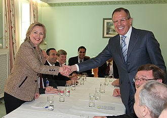U.S. Secretary of State Hillary Clinton and Russian Foreign Minister Sergey Lavrov shake hands after signing the New START Treaty, Munich, Germany, on February 5, 2011 Lavrov and Clinton in Munich-1.jpg