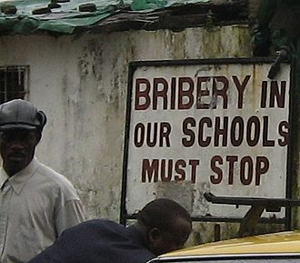 Corruption in Liberia - An anti-corruption sign in Liberia, 2004.
