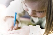 Little girl drawing with blue pencil.jpg