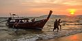 Long tail boat arrives to Ao Nang beach at sunset.jpg