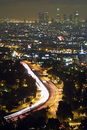 Nighttime view of Downtown L.A. and the Hollyw...