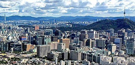 Seoul City and Lotte World Tower Lotte World Tower and Namsan Tower in Seoul.jpg