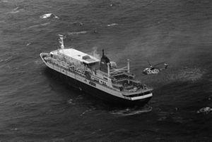 MS Prinsendam (1973) - Image: MS Prisendam sinking off Alaska with USCG HH 3F 1980