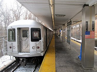 M (New York City Subway service) - An M shuttle train at Middle Village–Metropolitan Avenue during reconstruction of the Myrtle Avenue Line's junction with the BMT Jamaica Line