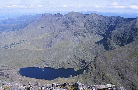MacGillycuddy's Reeks, mountain range in County Kerry includes the highest peaks in Ireland. Macgillycuddy's Reeks, Lough Callee and Cnoc na Peiste (Knocknapeasta) - geograph.org.uk - 1434579.jpg