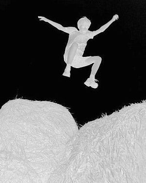 Negative image of the boy Guy jumping...