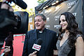 Madeleine Stowe and Father Rick Frechette at APJfest14.jpg