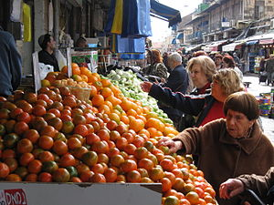 Consumer behaviour - Shoppers inspect the quality of fresh produce at a market in Jerusalem.