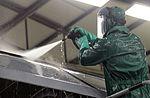 Maintainers clean before painting, inspecting 160104-F-EN010-034.jpg