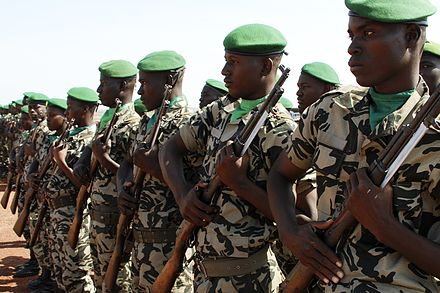 Do groups have rights? Some argue that when soldiers bond in combat, the group becomes like an organism in itself and has rights which trump the rights of any individual soldier. Malian Soldiers.jpg
